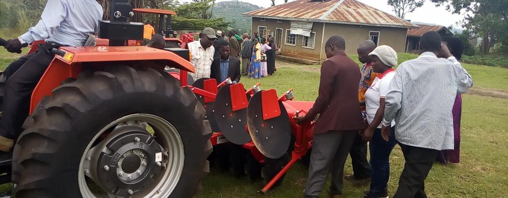 Handing over NAADS Tractors